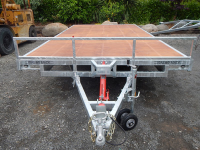 Custom trailer with plywood flat deck.