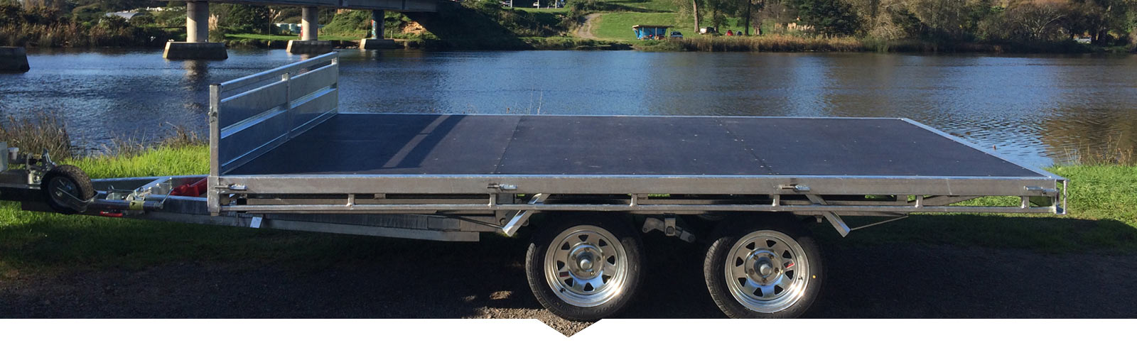Contact Trailor Made for black plywood flat deck trailers.