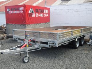 Tandem axle tilt trailer with solid plate alloy sides.